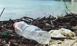 Browse partner plastic bottle on the beach